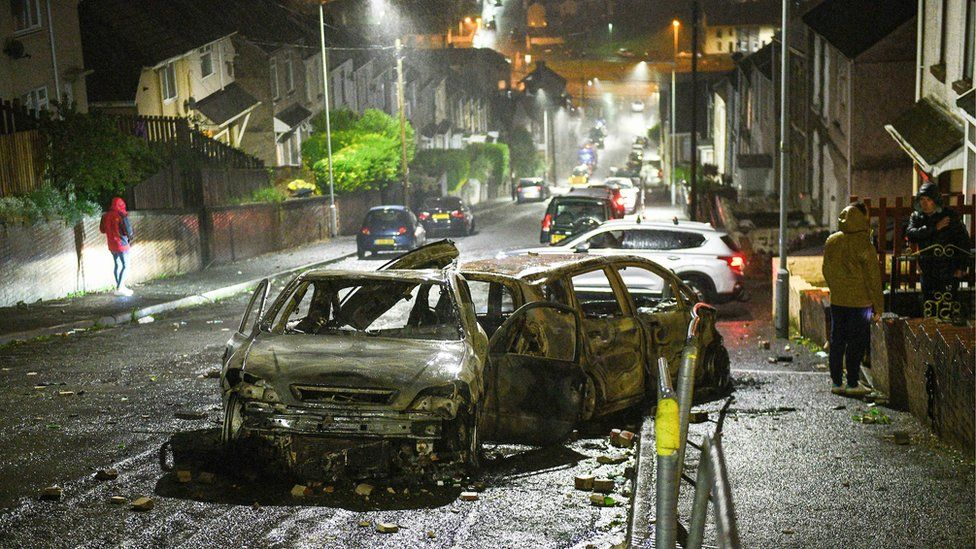 Mayhill: Cars were left burnt out when violence erupted in Mayhill on Thursday