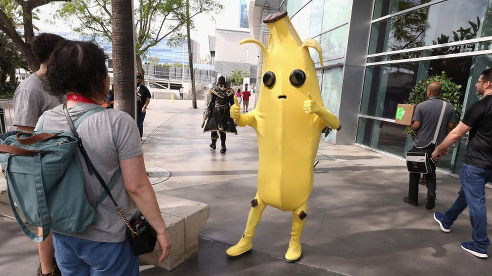 An actor dressed as Fortnite's Peely the banana character