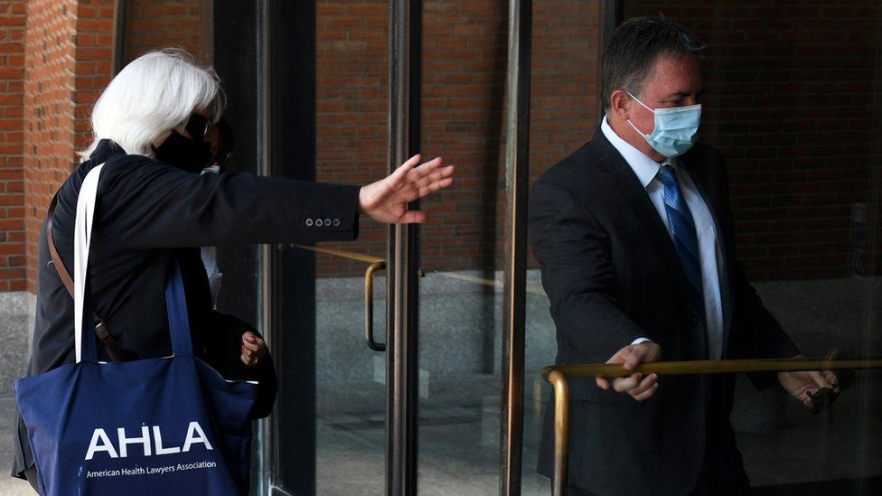 Philip Cooke (right) arrives for sentencing at a Boston court