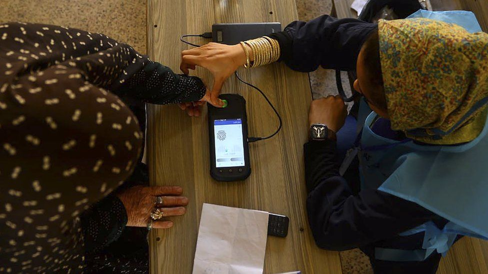 A fingerprint is read at a polling station in 2019