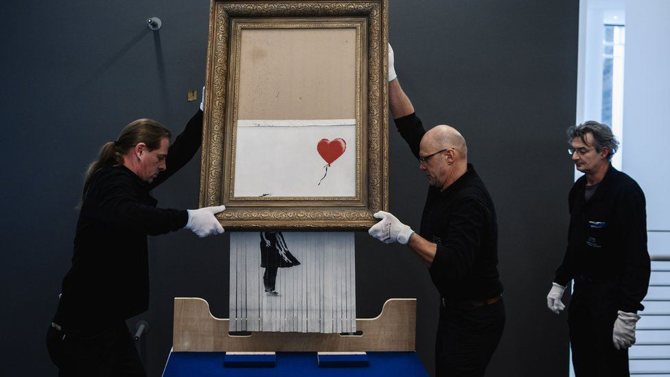 Banksy's Girl with Balloon was shredded seconds after the hammer fell at an auction at Sotheby's in October 2018