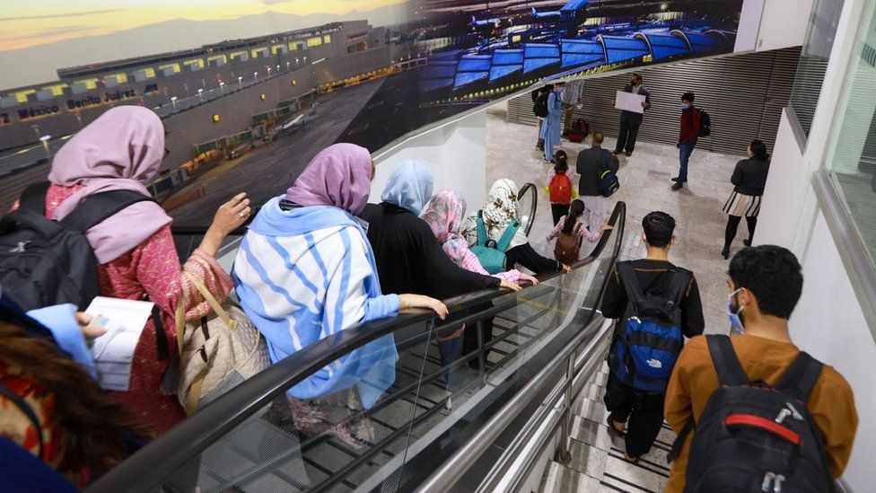 A group of Afghan citizens arriving at the Mexico City International Airport