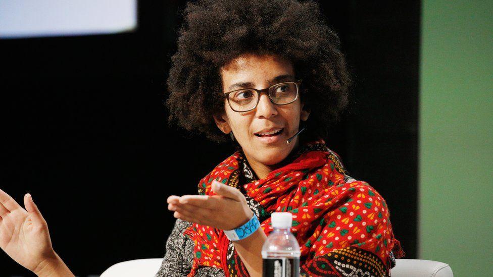 Image caption, Timnit Gebru speaking in 2018